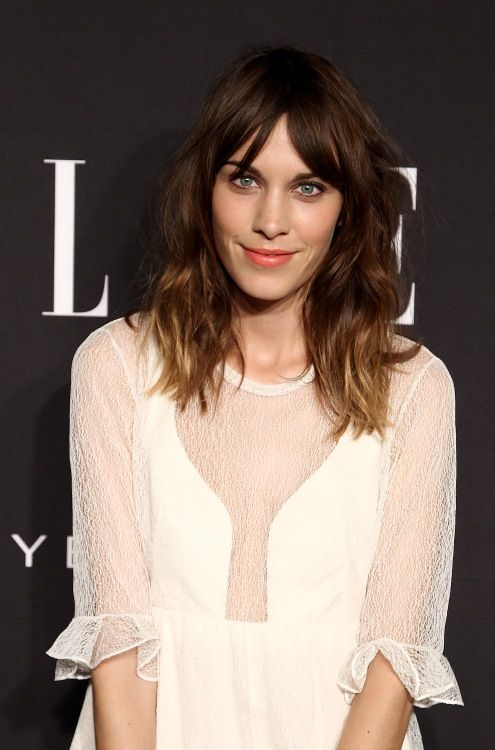 Parted bangs and wavy mid length.