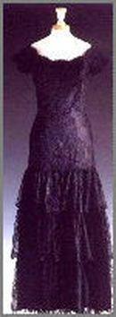 Magenta silk Goya -esque dress over laid with black lace. Designer Victor Edelstein Price raised : $25,300