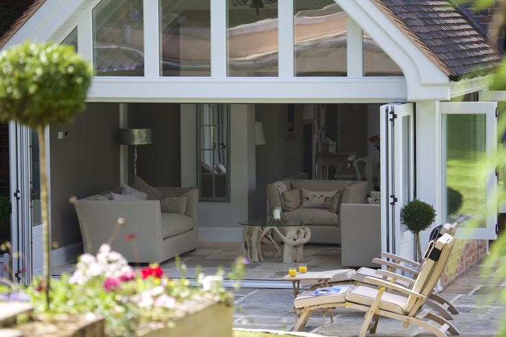 One of our beautiful sets of bi-folding doors, seamlessly bringing the indoors out.