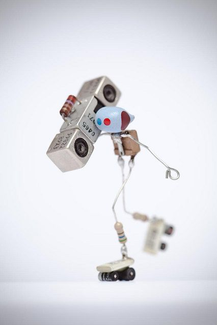 """Spare bits = spare bots. Time on hands + obsession with uselessness = make trivial things. Made from capacitors, diodes, resistors, leds, bits of wire, solder, and time..."" – Lenny & Meriel. http://avaxnews.net/funny/SpareBots_by_Lenny_and_Meriel.html"