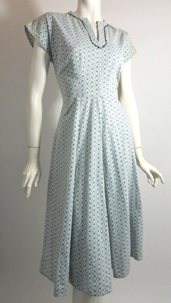 1940s house dress - my mom wore these well into the 50s. Most housewives wore house dresses, not slacks or pants.