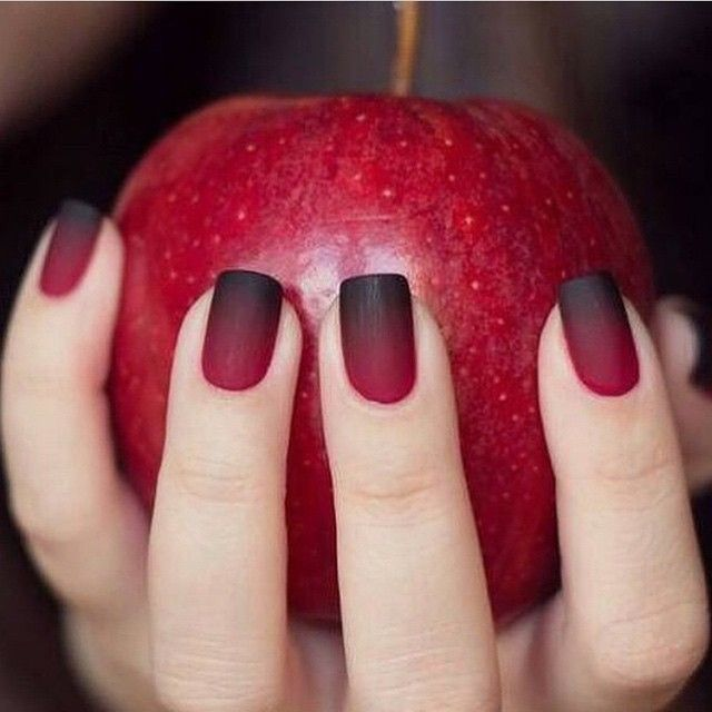Red faded into black matte nails