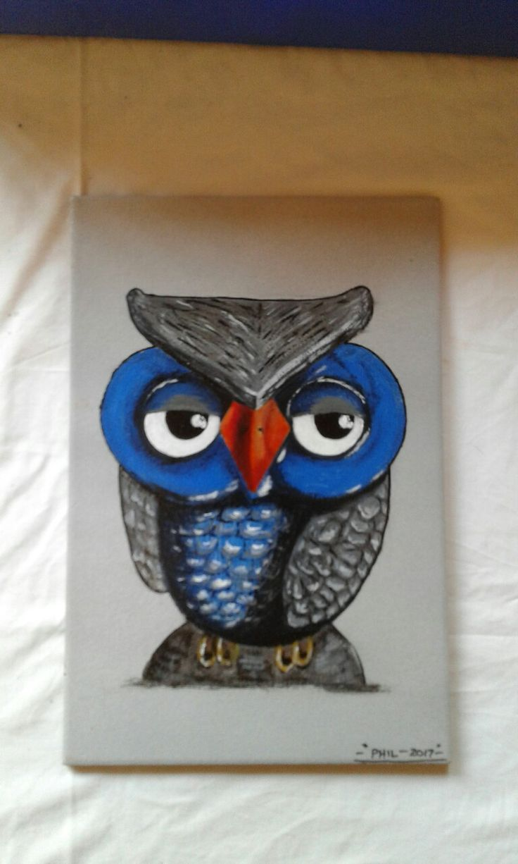 Owl painted on a ceramic tile