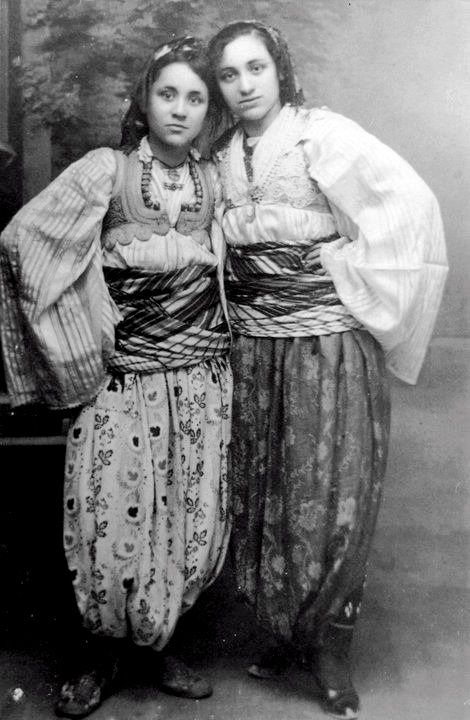 indypendenthistory:  MOTHER TERESA (1910-1997), on the left, as a teen in native Albanian clothing.   Mother Theresa!