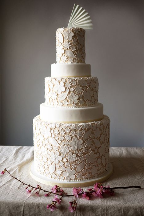 Ivory Lace by Charm City Cakes - Stunning lace detail on this five layer traditional cream and white cake makes any wedding all the more memorable.