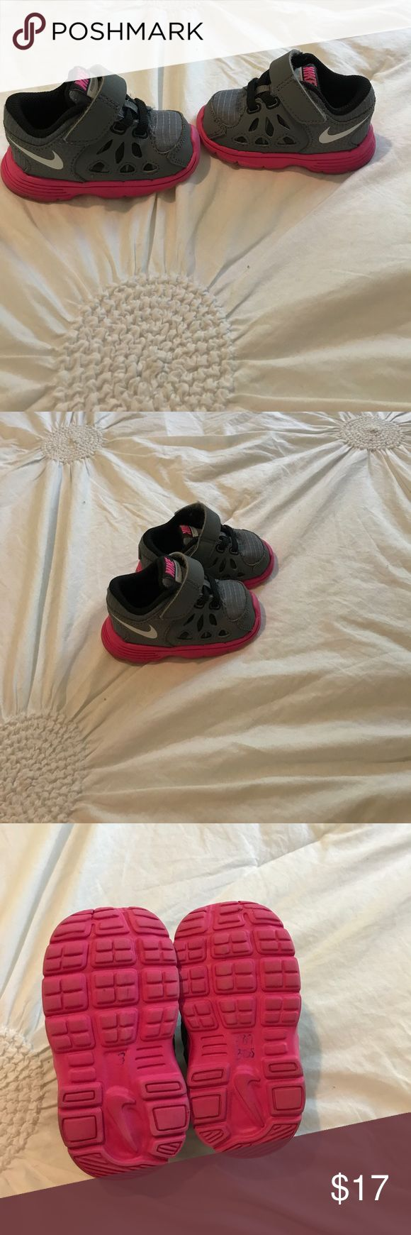 Adorable baby girl Nike shoes size 3C!! Adorable pink and gray Nike baby girl shoes size 3C in amazing used condition small SKU number written on the bottom of the shoe as shown in photo still in great condition. Nike Shoes Sneakers