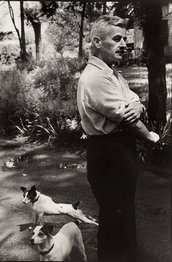 William Faulkner and his equally distinguished canine friends. Photo by Henri Cartier-Bresson