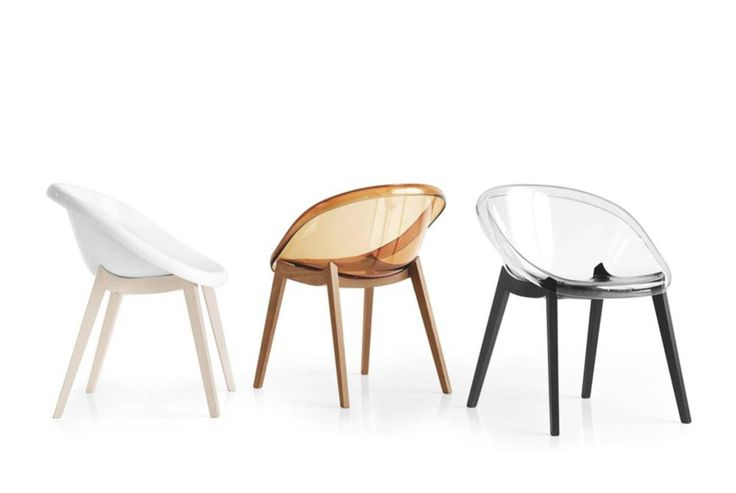 Calligaris Bloom dining chairs with wooden base.