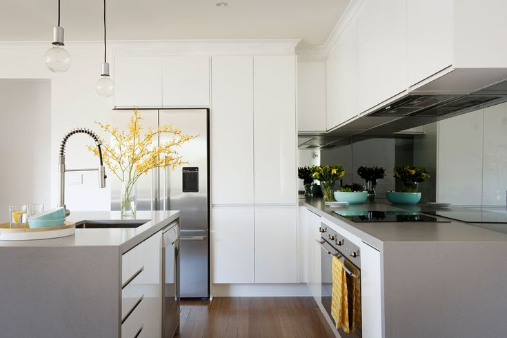 Freedom Kitchens Caesarstone Sleek Concrete Modern Industrial White Kitchen with Glass Splashback