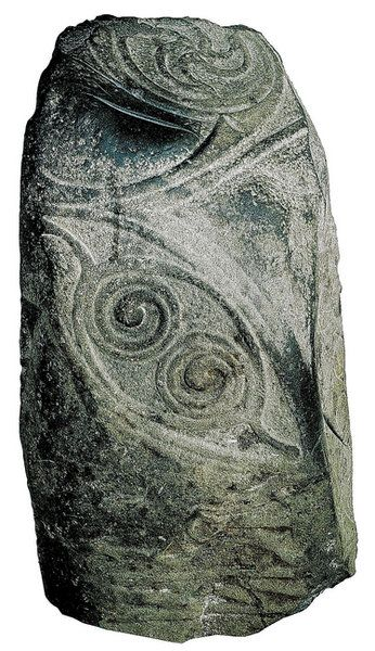 The Mullamast Stone, from 500-600 in Ireland. There are 4 blade marks on the left side of the stone and 2 deep ones on top, suggesting that the stone was used as part of a 'sword in the stone' kingship ritual from the Arthurian legend. Demonstrates the continuity of Celtic rituals even after the arrival of Christianity in Ireland.