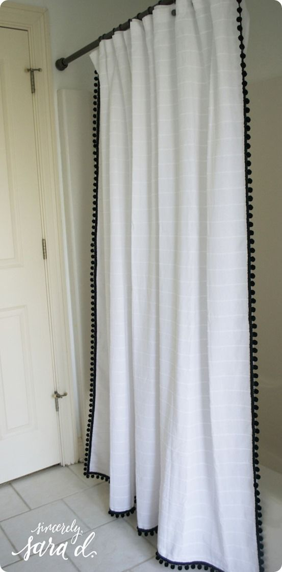 DIY Home Decor ~ Add interest to a plain shower curtain by hot gluing pom pom trim to the edges. {Ballard Designs Knock Off}