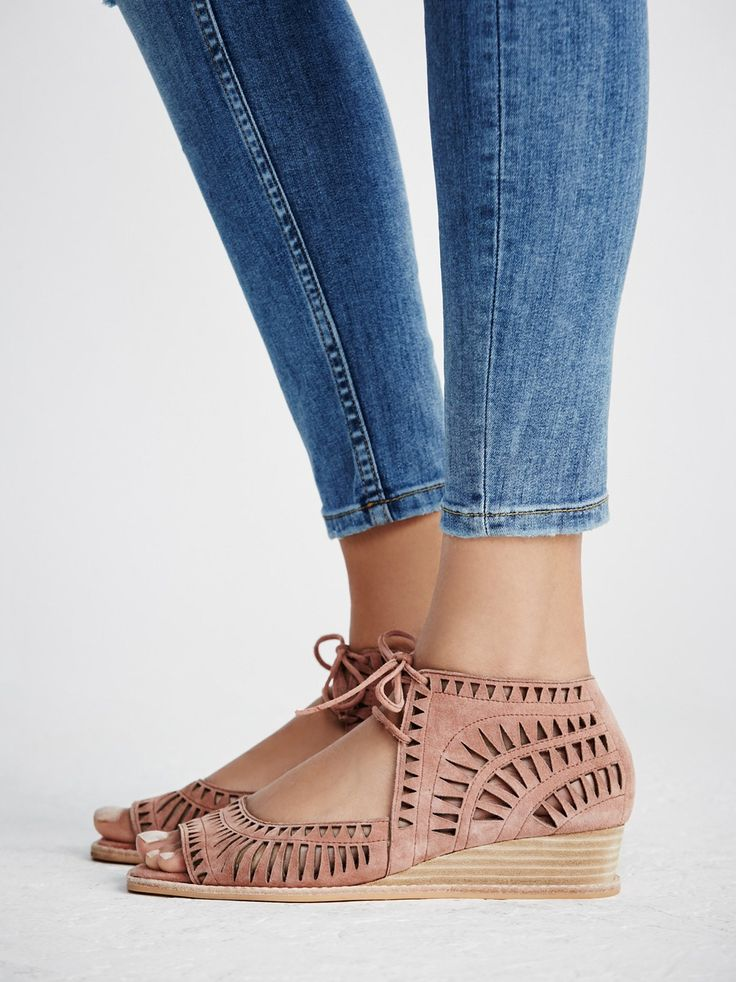 Serena Mini Wedge | In a smaller wedge version of our favorite Jeffery Campbell Serena Wedge these mini wedges are in a laser cut leather. Featuring an open toe, adjustable lace-up detailing and stacked wedge. Padded footbed for extra comfort. Rubber sole.