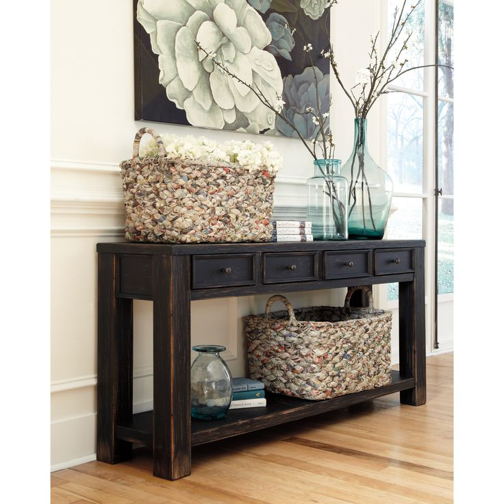 Chic and vintage, the Gavelston Sofa Table will bring cottage-inspired style to any living room or dining area. Crafted with durable hardwood, this rustic Ashley Furniture design is coated with a rich weathered black finish.