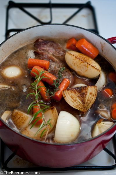 How to Make Pot Roast.  Made on 12/28/13, delicious.  Used a Pale Ale and added mushrooms and small red potatoes.  Used vegetable broth bc I had no beef broth.  Cooked on low in my crock pot for 9 hours after I seared the veggies and meat in my dutch oven.