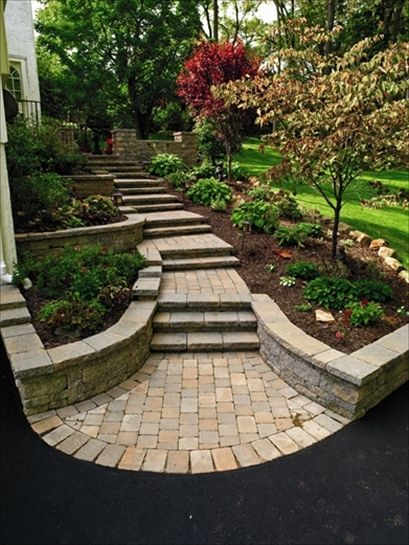 Path and steps - I like this idea for an entry to the front door. with a raised planter that recesses to the yard which I would level off completely with the sidewalk