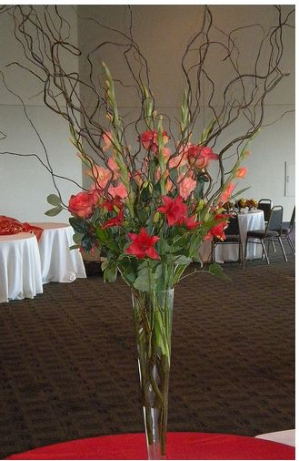 Picture of tall slim wedding centerpiece with flowers and for Floral arrangements with branches