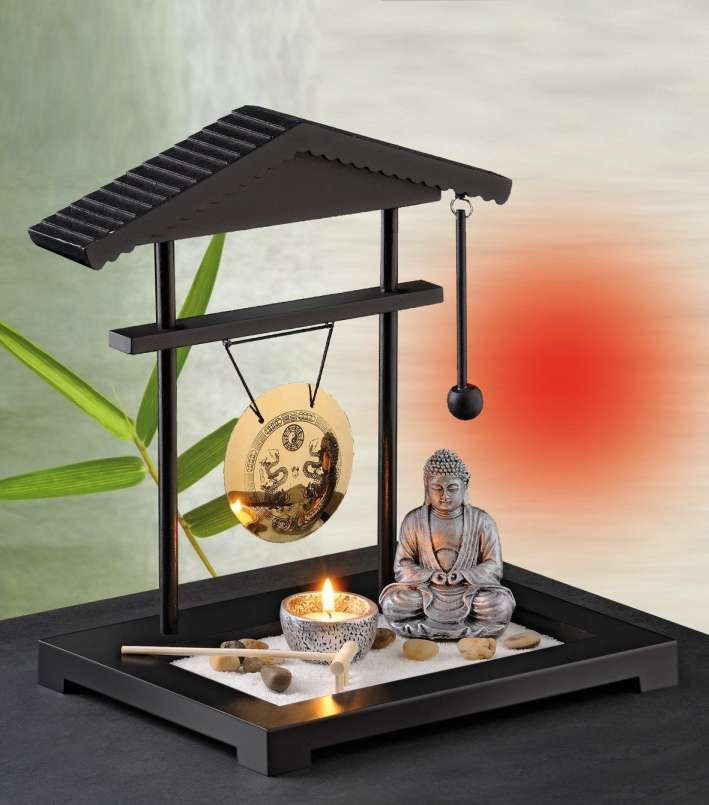 A Zen Garden With Gravel Surfaces Shaped Woods And Stones Radiates Peace And Harmony We Give Tips On H Zen Garden Design Miniature Zen Garden Mini Zen Garden
