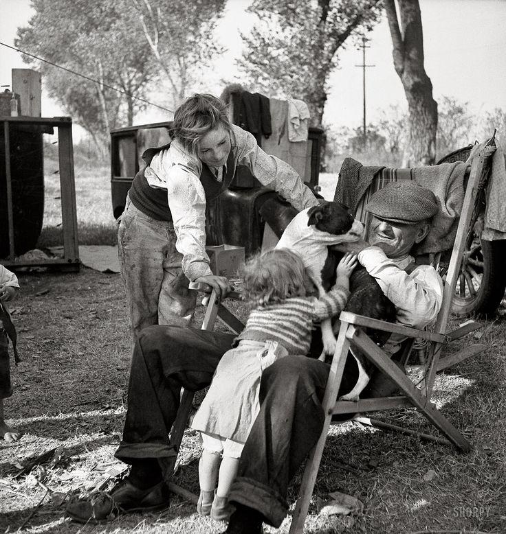 "November 1936. ""American River camp, Sacramento, California. Destitute family. Five children, aged two to seventeen years."""