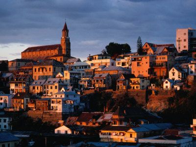The capital of Madagascar, Antananarivo is in many ways more like a provincial French town than an African city. Centred on a long rocky ridge, it is topped by two cathedrals, government buildings and even the remains of a royal palace that was set on fire in 1995. Spreading down from the ridge is a jumble of ancient streets and houses.