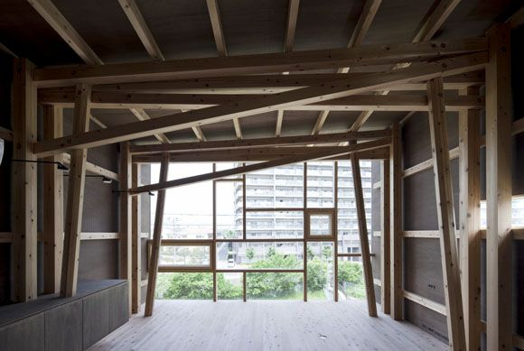 House of Japanese Cedar by Suga Shotaro / Suga Atelier. The structure of this residence is composed of Japanese cedar columns, fashioned from from processed forest thinnings. The composite columns and beams eliminate the need for heavy load-bearing walls. The exposed, angled, structure creates a rich and varied interior, visible through the end of the building, which is fully glazed.