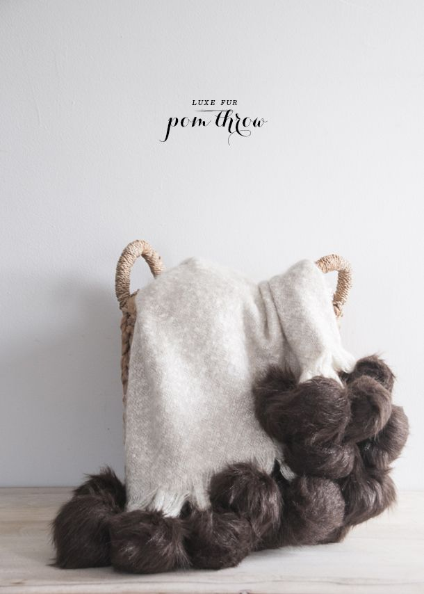 I have loved all of the fur pom throws I've seen around the webs over the past year or so and have always loved how girly and lavish they feel. Pom poms are awesome on their own, but in fur they reall