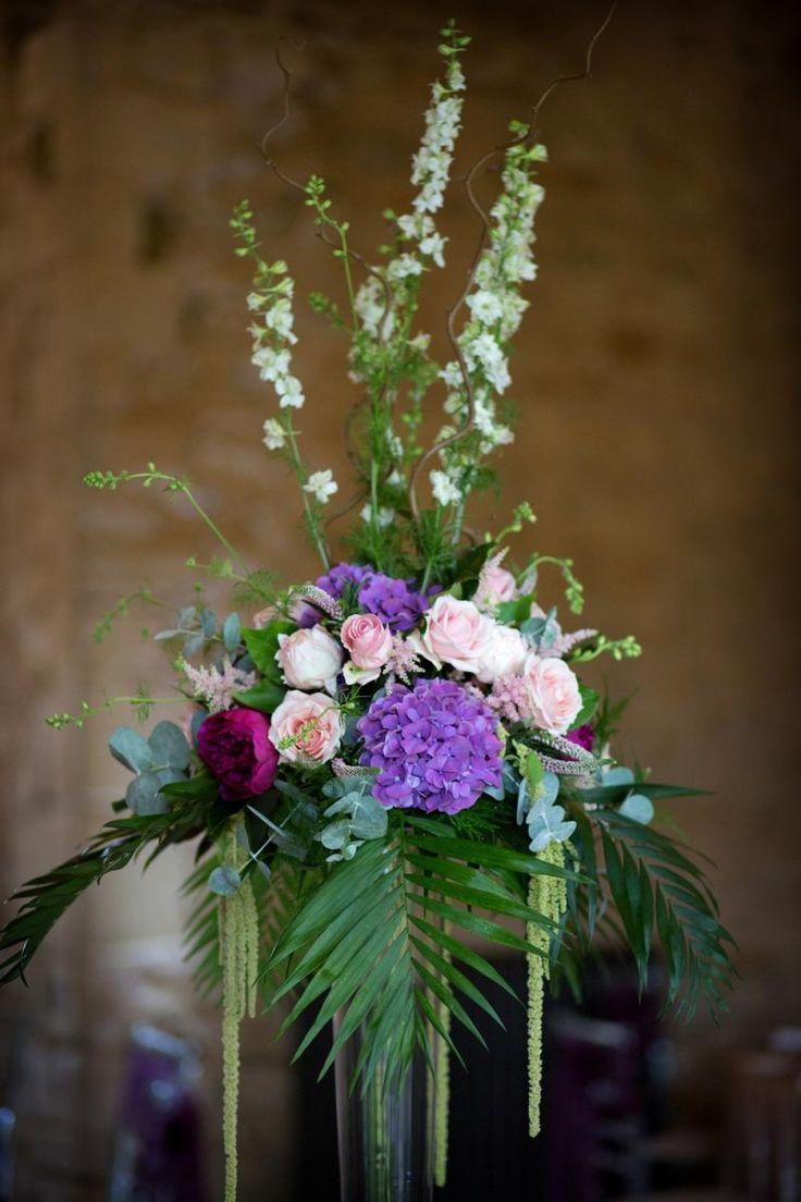 Floral Wedding Reception Decor #NotleyAbbey #WeddingVenue #Wedding #BuckinghamshireWeddingVenue #LuxuryWedding #BarnWedding #WeddingFlowers #Purple