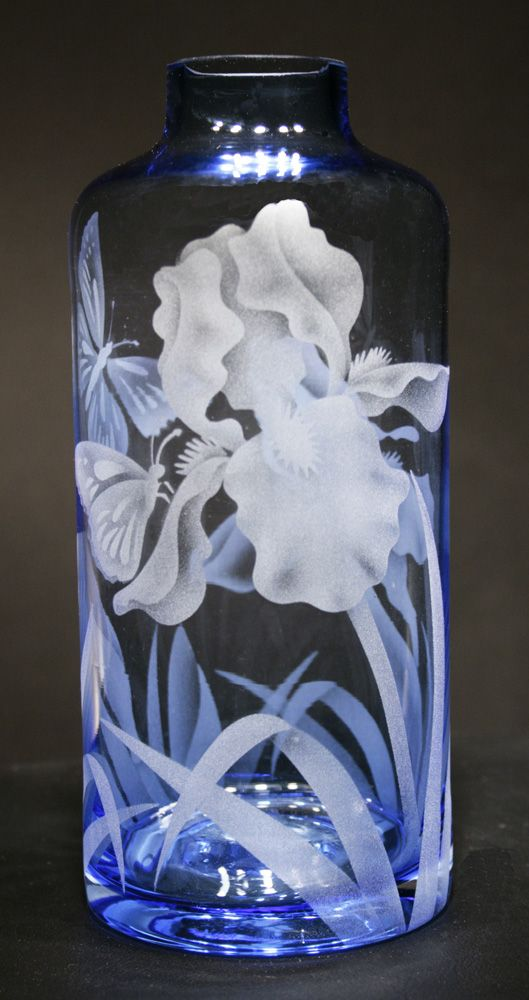 Butterflies in the bearded iris etched on a soft blue bottle vase