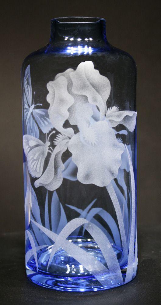 Butterflies in the bearded iris etech on a soft blue bottle vase. Jaguar Art Glass - Glassware