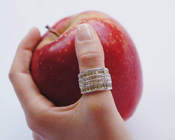 Rows of Baguettes Ring: This statement cocktail piece is simple yet luxurious. A stunning ring with rows of baguettes channel set in wide band. Cubic zirconia, real rhodium electroplated over brass. $165.00
