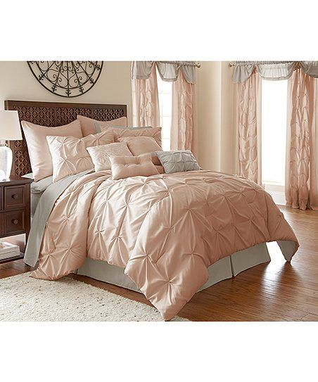 Give your entire bedroom a makeover with this comprehensive set that includes a comforter, shams, decorative pillows, sheets, pillowcases and window treatments. Elegantly gathered fabric brings modern elegance to your look.