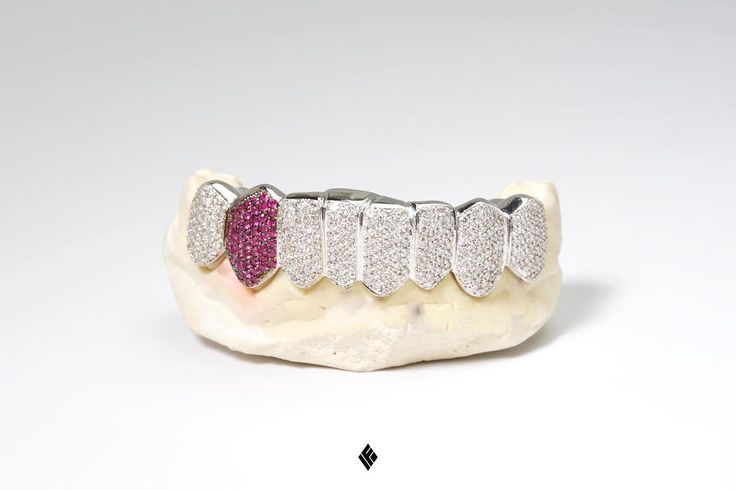 14kt Solid White Gold Bottom #AWGE X #IFANDCO Limited Collaboration Grill fully iced out with white diamonds and ruby canine special made for @daksedg916. #Grillz #CustomJewelry #AWGE #IFANDCO