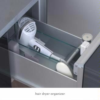 Hair dryer organizer  This drawer insert has a practical, engineered docking ring that presents the hair dryer at the proper angle. Storage areas enable other hair appliances to remain plugged in.