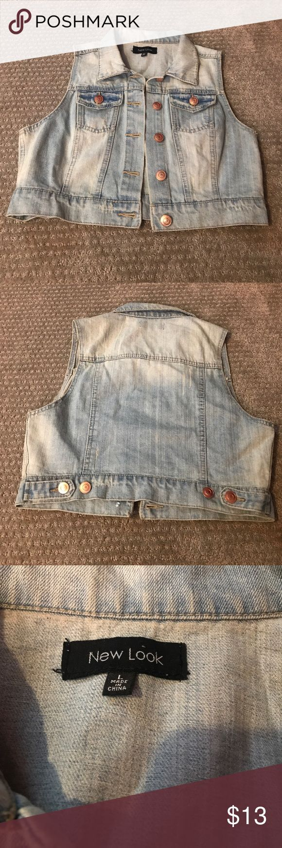 Sleeveless Jean jacket light wash Brand is New Look. Size large but fits a size down. Light wash with etchings is beautiful on this jacket! Perfect condition. Buttons are copper color. New Look Jackets & Coats Jean Jackets