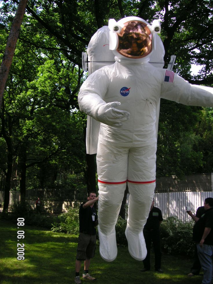 Radio controlled astronaut being prepared for flight