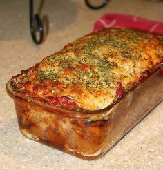Parmesan Meatloaf: 2lbs Gr. Beef;1/2 c Parmesan Cheese;1/4 c Dijon Mustard;1/2 c Ketchup;2 tbs Majoram;1 tbs dried basil, dried parsley, oregano, thyme;1 tsp salt;2 tsp pepper;1/2 c mozzarella cheese;4 cloves garlic;1/4 c gr pepper;1 onion,;1/2 c spaghetti sauce;1 tbs olive oil;1 egg. Combine beef, egg, seasonings, and dressings. Put into  pan.Top with sauce & cheese. Put bottom rack, bake at 375 45 min - 1 hour. Rest for 5-10 min.