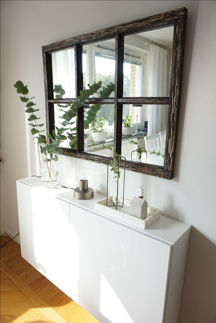 Vintage dark stained wood mirror and a Wall cabinet form IKEA.