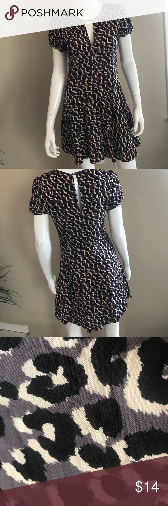 Forever 21, black and lavender purple dress. Fun animal print, mini dress. Shows it's a size medium, but it's a small. Zipper on left side. 100% polyester, hand wash cold, dry flat. Only worn once. Excellent condition. Forever 21 Dresses Mini