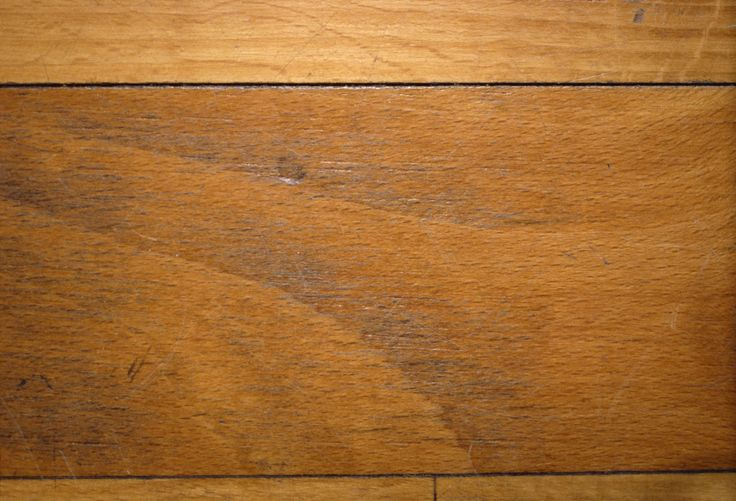 Deodorize musty wood floors with white vinegar.