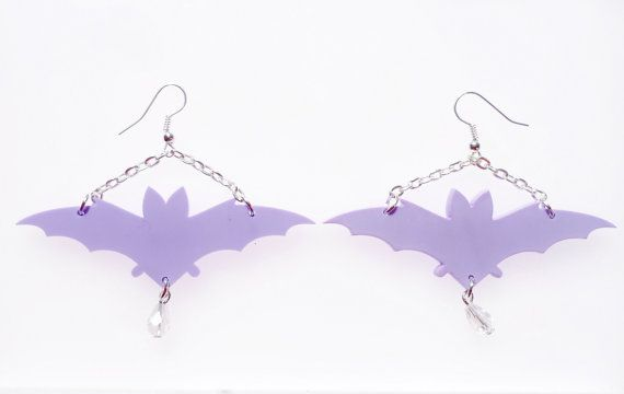 This piece consists of two bat silhouettes cut from 3mm pastel acrylic. Each earring is of chandelier style hanging from one inch siver