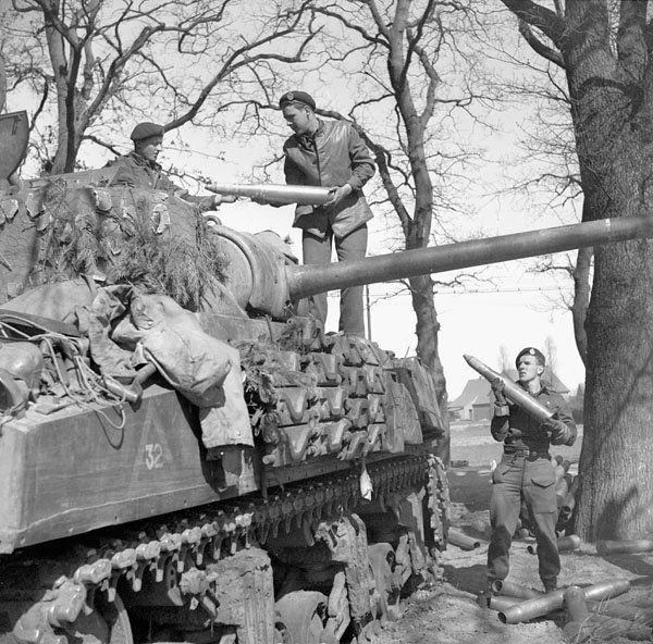 Sherman tanks of Headquarters Squadron, The British Columbia Regiment, shelling a German position near Meppen, Germany, 8 April 1945.