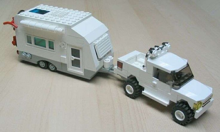 Legos truck pulling a travel trailer!! How awesome!