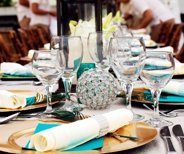 Turquoise blue was integrated into the table setting to symbolize water as a nod to the couple's astrological signs.