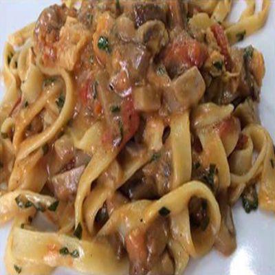 Fettuccine ai porcini, pomodorini e Grana Padano