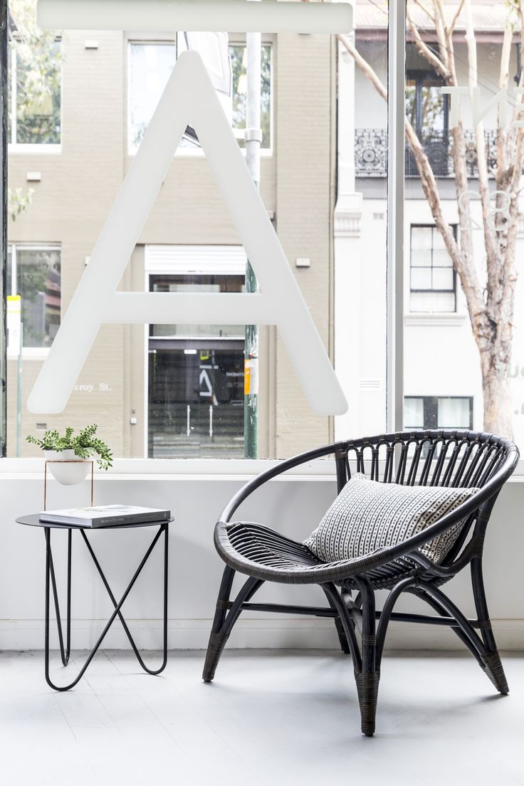 The Easy Chair by Feelgood Designs is perfectly named, the soft contours exuding a laid-back nature. These curved shaped are echoed in the Mabel Side Table, which look great as a pair contrasting against the stark white floors.