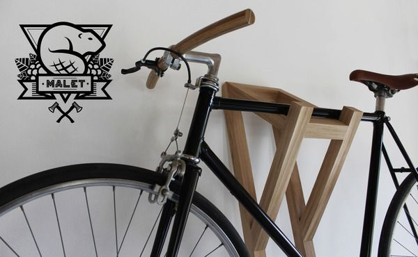Bike hanger # I by Malet Thibaut, via Behance. Elegant and refined solution for hanging a bike up and out of the way!