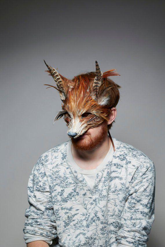 картинки человека в маске животных