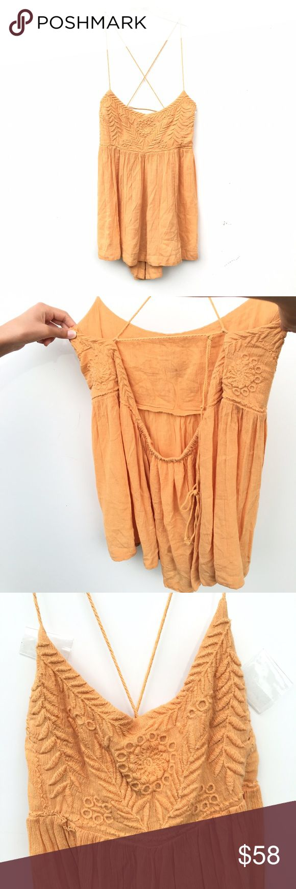 Free People Blackbird Top Brand new and without tags gold / orange-yellow Free People tank top. Straps are yarn like and cross over in back as shown. Straps are adjustable. Free People Tops Tank Tops
