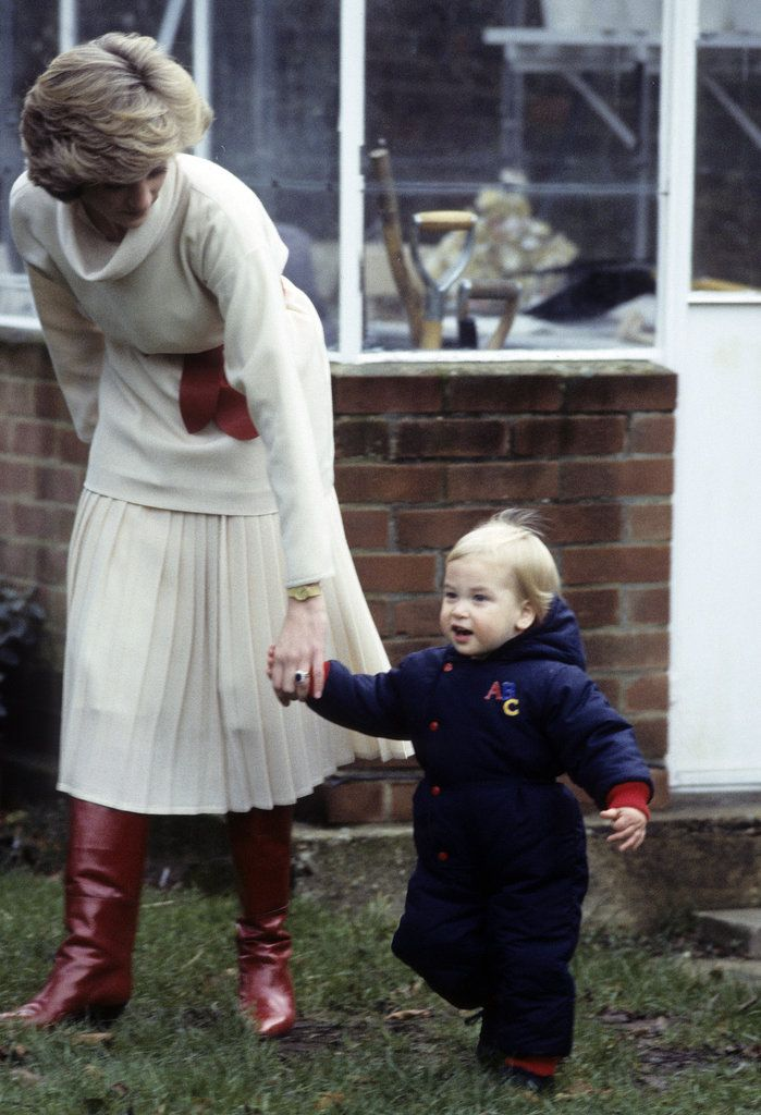Princess Diana's Sweetest Mum Moments .. Prince William held onto Princess Diana's hand while walking through the gardens of Kensington Palace in December 1983.