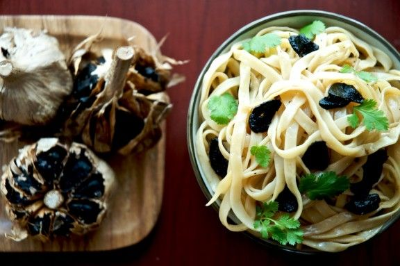 Black garlic has been on my list of ingredients to cook with and now thanks to my friend, Jaden of Steamy Kitchen who had a package of black garlic cloves sent to me via David of Earthly Delights, black garlic is gently perfuming my kitchen with it's mild pungence. I grew up with fiercely fermented,…