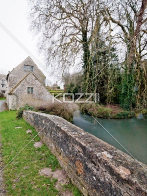 stone wall and willow tree - A stone wall next to a river and a willow tree